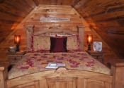 Queen size bed in the open loft