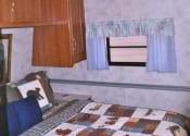 queen-size-bed-in-coachman-camper